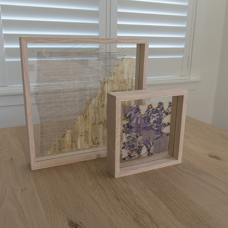 Two frames on table